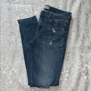 Gently used mid-rise distressed skinny jeans